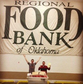 Blake and I posing with some of the food QuiBids donated at the Food Bank's warehouse. That banner is huge!