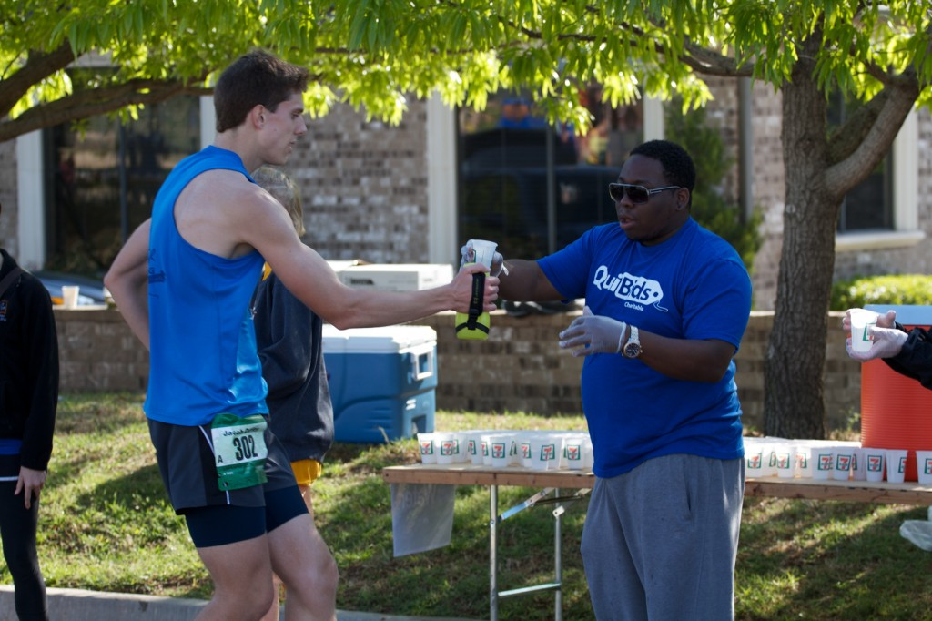 One of our employees, Jeremy, with a great hand off of water for one of the runners.