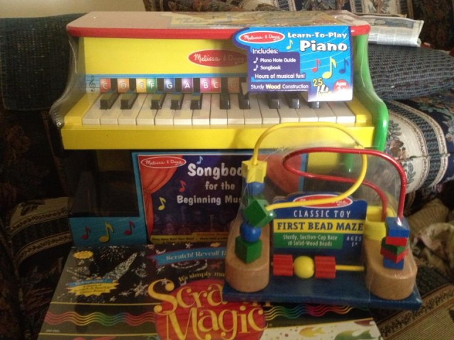 QuiBidder John S. sharing a photo of the melissa & doug toys he won on QuiBids and intends to donate to charity