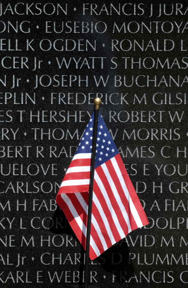 American flag at Vietnam Veterans Memorial by Unknown