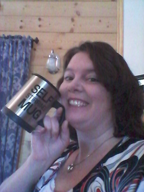 Cindy won this self-stirring mug on QuiBids for $1.27! She used 8 voucher bids and saved 94% off! #QuiBidsWin