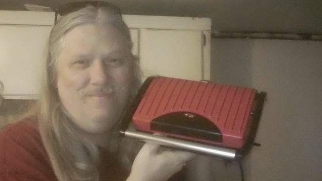 David used 10 voucher bids to win this grill and panini press for only $0.26! #QuiBidsWin
