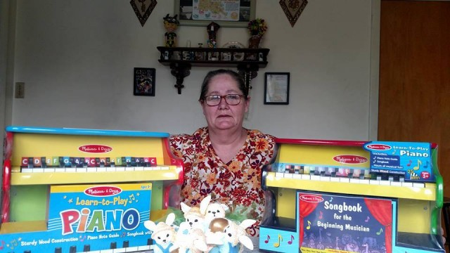 Phyllis shows off the two Melissa and Doug toy pianos she won on QuiBids. #QuiBidsWin