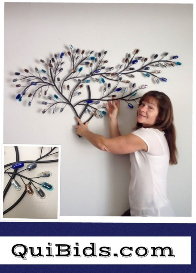 Janise loves the glass tree sculpture she got on QuiBids!