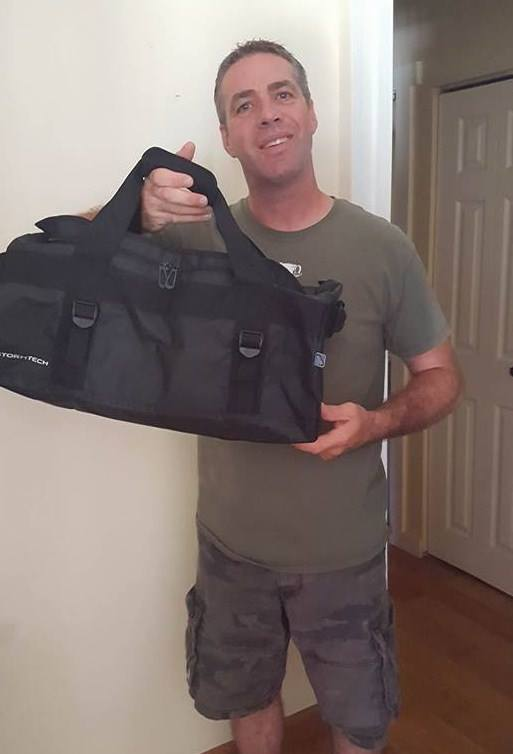 Doug won this waterproof gear bag for $1.01 using 18 voucher bids! #QuiBidsWin