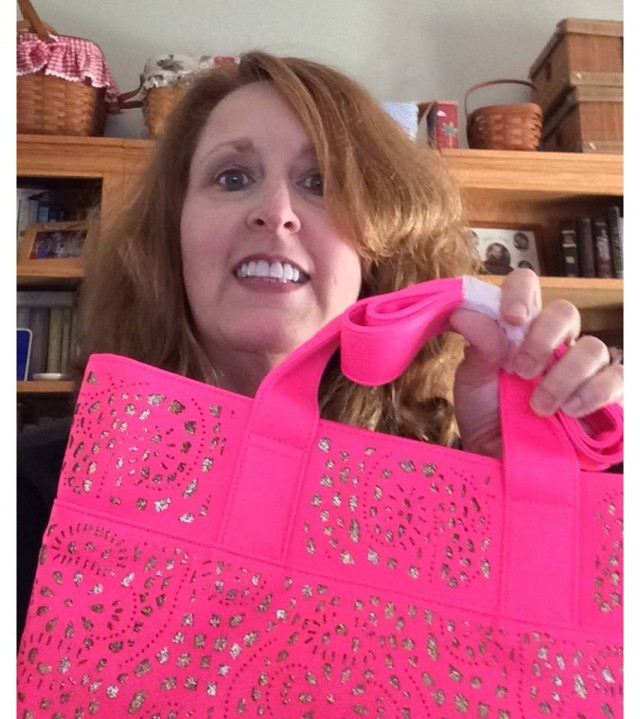 Connie won this neon Olivia Miller tote for $0.35 and used only 10 voucher bids! #QuiBidsWin