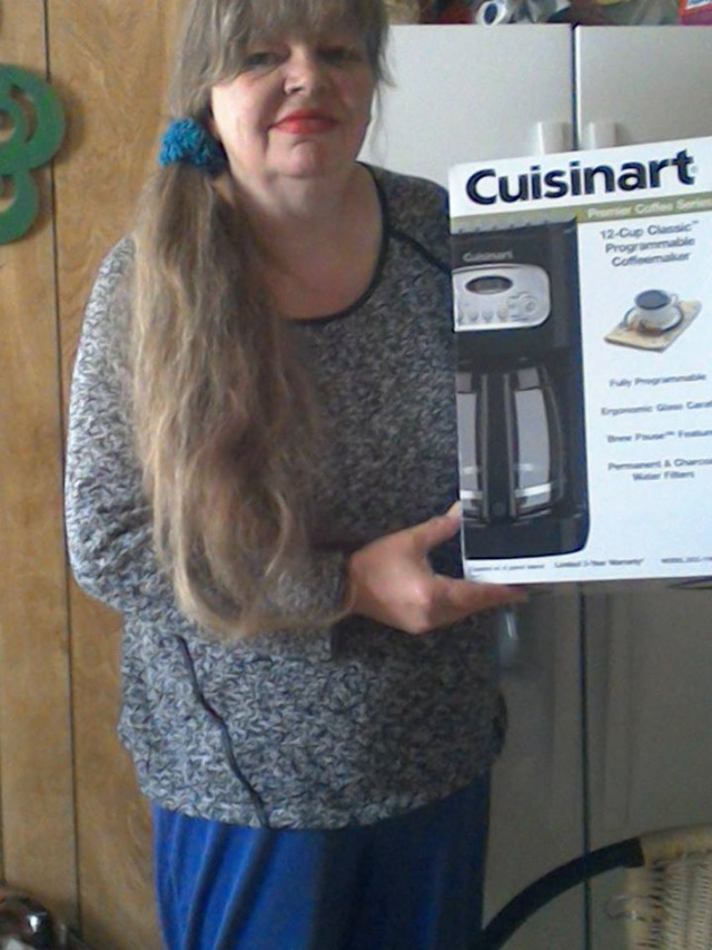 Cathy won this coffee maker for $0.29 using 14 real bids! #QuiBidsWin