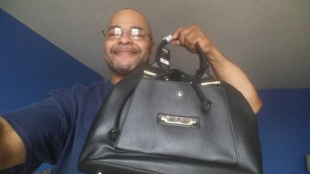 Jeffrey used 14 real bids and 20 voucher bids to win this Versace handbag for only $10.73! #QuiBidsWin