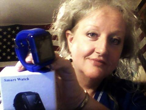 Teresa won this BlueTooth watch for $0.02 using only one real bid and saved 99%! #QuiBidswin