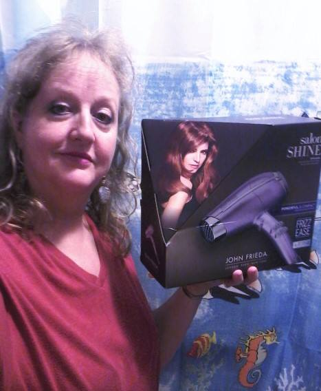 Teresa won this hair dryer for $0.35 using only 16 voucher bids and saved 99%! #QuiBidswin