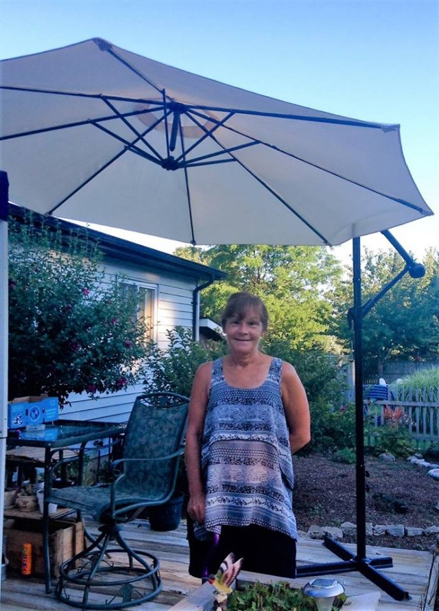 Janice won this hanging patio umbrella for $5.65 using 176 voucher bids! #QuiBidsWin