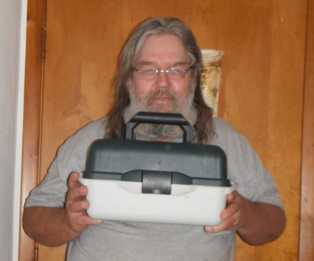 William won this fishing tackle box for $1.15 using only 2 real bids!