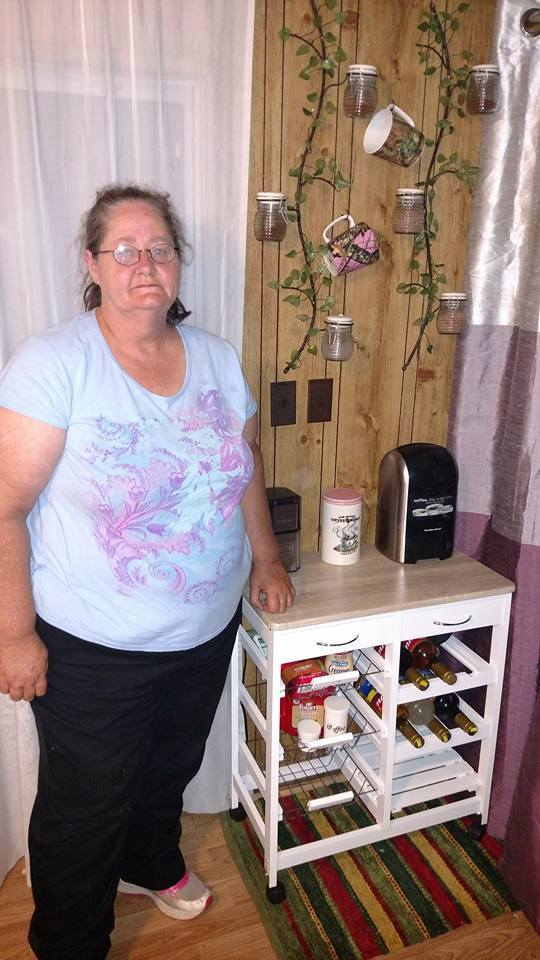 Phyllis won this wine rack for $2.24 using only 42 voucher bids! #QuiBidswin